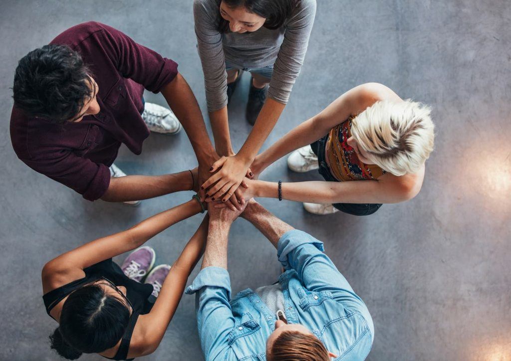 Team members Hands in Circle